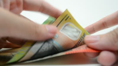 stock-footage-close-up-of-hands-counting-australian-bills